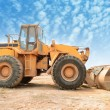 Bulldozer on a building site — Stock Photo #25327167