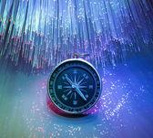 Compass on fiber optic background — Stock Photo