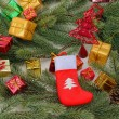 Christmas sock with gifts — Stock Photo