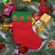Christmas sock with gifts border frame — Stock Photo