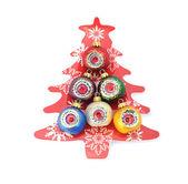 Beautiful Christmas balls on plate — Stock Photo