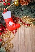 Christmas sock with gifts border frame — Stock Photo
