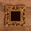 Golden vintage frame isolated on wooden  background — Stock Photo