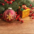Christmas baubles on wooden background — Stock Photo