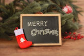 Board with Christmas decoration on wooden background — Stock Photo