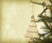 Christmas tree on Vintage christmas background — Stock Photo