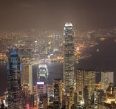 Hong Kong city skyline panorama at night with Victoria Harbor an — Stock Photo