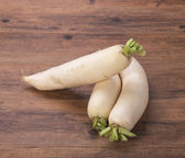 Daikon radish on the wood background — Stockfoto