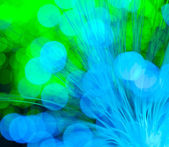 Optical fibres dinamic flying from deep on technology background — Stock Photo