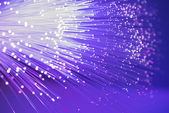 Optical fibres dinamic flying from deep on technology background — Foto Stock