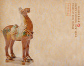 Ceramic horse souvenir on old paper,2014 is year of the horse — Stockfoto