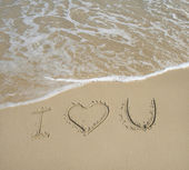 I love U on the sand texture background — Stock Photo