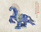 Ceramic horse souvenir on old paper,Chinese calligraphy. word fo — Stock Photo