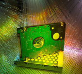 Harddisk with fiber optical background — Stock Photo