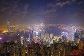 Hong Kong city skyline panorama at night with Victoria Harbor an — Foto Stock