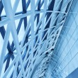Contemporary office building blue glass wall detail — Stock Photo #47277409