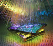 Harddisk with fiber optical background — Stock Photo