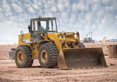 Bulldozer on a building site — Stock Photo