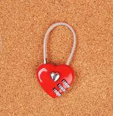 Heart shape lock locked up with wood background — Stock Photo