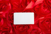 Blank stamp shape card with rose petals as a symbol of love — Stock Photo