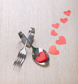 Red heart with fork and scoop on wooden background — Foto de Stock