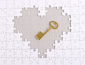 Golden Key with heart shape puzzle — Stock Photo
