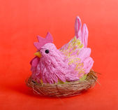 Easter hen on red background — Stock Photo
