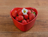 Strawberries in glass bowl — Stock Photo
