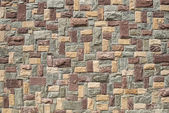 Hand made rustic rock wall — Stock Photo