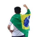 Brasilianska man firar med flagga och mask — Stockfoto