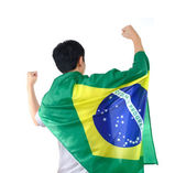 Brazilian man celebrates with flag and mask — Stock Photo