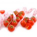 Cocktail tomatoes on white — Stock Photo