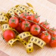 Tomatoes and tailor tape — Stock Photo