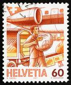 Affranchissement timbre de poste aérienne de la Suisse 1987 chargement, manutention de courrier — Photo