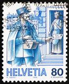 Postage stamp Switzerland 1986 Postman, Mail Handling — Stock Photo