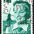 Postage stamp Netherlands 1951 Girl and Windmill — Stock Photo