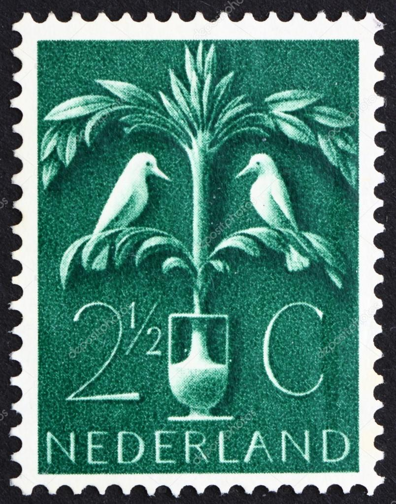 NETHERLANDS - CIRCA 1943: a stamp printed in the Netherlands shows Tree of Life, Old Germanic Symbol, circa 1943 — Stock Photo #12230420