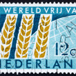 图库照片: Postage stamp Netherlands 1963 Wheat Emblem and Globe