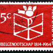 图库照片: Postage stamp Netherlands 1964 Bible, Chrismon and Dove
