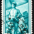 Stock Photo: Postage stamp Italy 1950 Sailor Steering Boat, Veneto