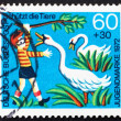 Postage stamp Germany 1972 Girl Boy Annoying Swans - Stock Photo