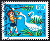 Postage stamp Germany 1972 Girl Boy Annoying Swans — Stock Photo