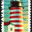 图库照片: Postage stamp US1990 West Quoddy Head, Maryland, Lighthouse
