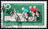 Postage stamp GDR 1962 Cyclists and Hradcany, Prague — Stock Photo