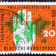 Stock Photo: Postage stamp Germany 1956 Map of World and Policeman�s Ha