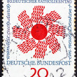 图库照片: Postage stamp Germany 1964 Radiating Sun