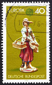 Postage stamp Germany 1976 Girl Selling Trinkets and Prints, Por — Stock Photo