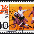 Postage stamp Germany 1974 Three Soccer Players — Stock Photo