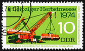 Postage stamp GDR 1974 Crane Lifting Diesel Locomotive — Stock Photo