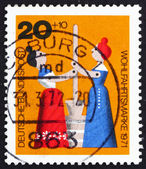 Postage stamp Germany 1971 Women Churning Butter, Wooden Toy — Stock Photo